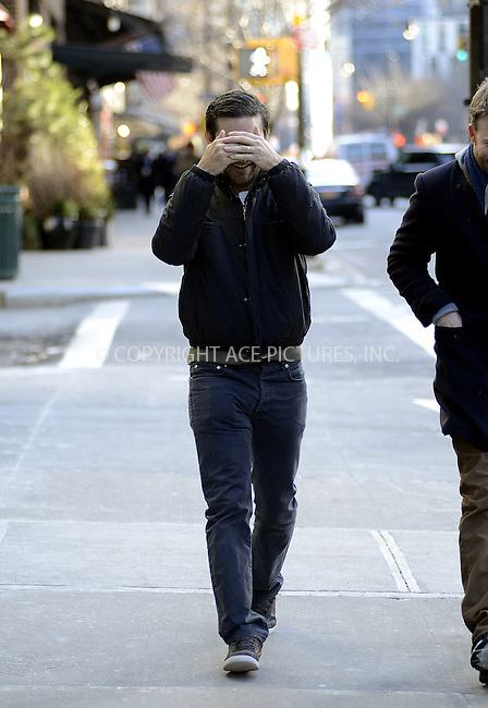 WWW.ACEPIXS.COM....February 4 2013, New York City....Arrogant Tobey Maguire decides that he can't even manage a smile or even a look at waiting fans and photographers as he arrives at his downtown hotel on February 4 2013 in New York City........By Line: Curtis Means/ACE Pictures......ACE Pictures, Inc...tel: 646 769 0430..Email: info@acepixs.com..www.acepixs.com
