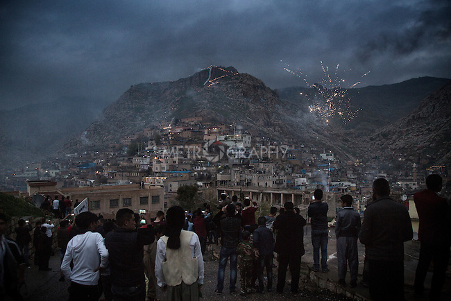 21/03/15 -- Akre, Iraq -- A crowd of people watches Newroz celebrations on top of Akre mountain from Sare Gree.