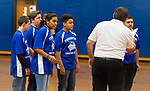TORRINGTON,  CT-031919JS01- Henry Marchand, the coach for the Torrington Middle School's unified basketball team, gives his starters a pep talk before their game  against Avon Middle School Tuesday at Torrington Middle School. It was the first home game for Torrington. <br /> Jim Shannon Republican American