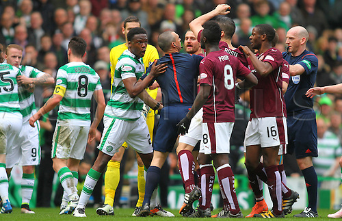 02.04.2016. Celtic Park, Glasgow, Scotland. Scottish Football Premiership Celtic versus Hearts. Dedryck Boyata is held back by the linesman from Igor Rossi