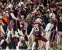 The tenth ranked South Carolina Gamecocks host the 6th ranked Clemson Tigers at Williams-Brice Stadium in Columbia, South Carolina.  USC won 31-17 for their fifth straight win over Clemson.  USC players celebrate South Carolina Gamecocks linebacker Skai Moore's (10) interception