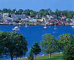 Lunenburg County, Nova Scotia<br /> Painted houses and buildings of Lunenburg rise on a hill above the blue waters and boats of the town harbor