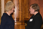 London, Uk. 15/10/2015. HRH The Duchess of Cornwall with Claire Whitaker, Chair of the Royal Commonwealth Society. The Duchess of Cornwall on behalf of Her Majesty The Queen, Patron of The Royal Commonwealth Society, holds a reception for winners of The Queen's Commonwealth Essay Competition at Buckingham Palace. The Queen's Commonwealth Essay Competition was founded in 1883 and is the world's oldest international schools' writing contest. This year's competition, sponsored by Cambridge University Press, received more than 13,000 entries from over 600 schools in 49 Commonwealth countries and territories. The Duchess of Cornwall hands out awards to young writers who have travelled from across the Commonwealth to attend the reception. This year's winners have come from Cyprus, Botswana, The Cayman Islands and as far away as Tristan da Cunha - over 9000km away.