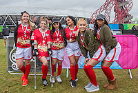 The Red team pose with there Runner Up medals (l-r) Fan Player, Robyn Regan, Tonia Gigli (PYT), Natasha Olrog (PYT), Liaa Gamito (PYT) & Naomi Labelle (PYT), during the SOCCER SIX Celebrity Football Event at the Queen Elizabeth Olympic Park, London, England on 26 March 2016. Photo by Andy Rowland.