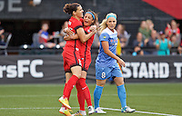 Portland, Oregon - Wednesday June 22, 2016: Portland Thorns FC forward Christine Sinclair (12) and forward Nadia Nadim (9) celebrate in front of Chicago Red Stars defender Julie Johnston (8)during a regular season National Women's Soccer League (NWSL) match at Providence Park.