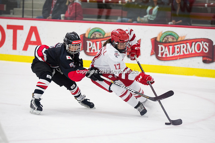 Wisconsin Badgers Blayre Turnbull (17) handles the puck against Team Japan's Mika Hori (7) during a women's hockey exhibition in Madison, Wisconsin, on September 23, 2013. The Badgers won 3-0. (Photo by David Stluka)