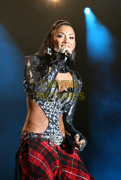 PUSSYCAT DOLLS- NICOLE SCHERZINGER.performing after racing at the Silverstone Classic meeting at Silverstone Racetrack, Northamptonshire, England 24th July 2009.playing live on stage gig concert performance music half length black sequins sequined red tartan plaid cut out away top jacket singing .CAP/JIL.©Jill Mayhew/Capital Pictures