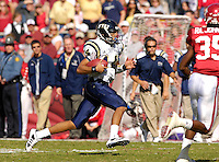 Florida International University Golden Panthers versus the University of Arkansas Razorbacks at Donald W. Reynolds Razorback Stadium, Fayetteville, Arkansas on Saturday, October 27, 2007.  The Razorbacks defeated the Golden Panthers, 58-10...FIU sophomore quarterback Wayne Younger (14) (Cocoa, Fla.) runs on a quarterback keeper in the second quarter.