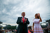 "U.S. President Donald Trump departs with first lady Melania Trump during the Fourth of July Celebration 'Salute to America' event in Washington, D.C., U.S., on Thursday, July 4, 2019. The White House said Trump's message won't be political -- Trump is calling the speech a ""Salute to America"" -- but it comes as the 2020 campaign is heating up. <br /> Credit: Al Drago / Pool via CNP"