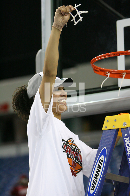 SACRAMENTO, CA - MARCH 29: Rosalyn Gold-Onwude cuts the net after Stanford's 55-53 win over Xavier in the NCAA Women's Basketball Championship Elite Eight on March 29, 2010 at Arco Arena in Sacramento, California.