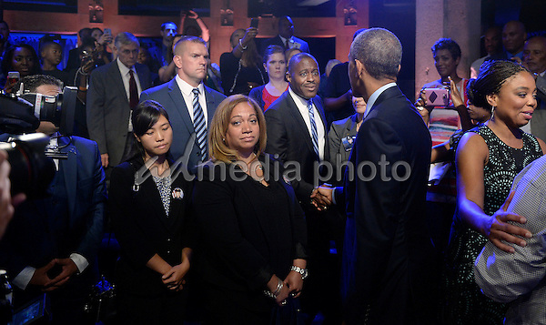 United States President Barack Obama greats guests after speaking at a town hall hosted by ABC to engage directly with officers, parents, students, community leaders and families on trust and safety in the communities at the Studio Theater July 14, 2016 in Washington, DC. Photo Credit: Olivier Douliery/CNP/AdMedia