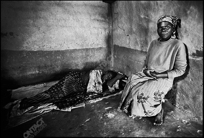 Woman with AIDS and TB being cared for by her sister, Place shanty town, Nkwazi, Ndola, Northern Zambia, January 2000