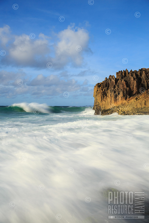 The surf rushes onto the shore along the Maha'ulepu Heritage Trail, southern Kaua'i.