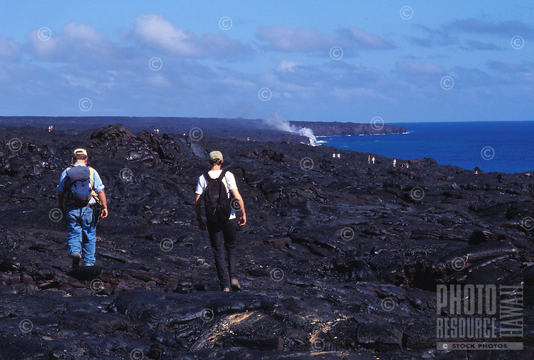 Visitors hike over lava flows to new eruption site, Hawaii Volcanoes National Park