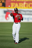 Michael De Leon (1) of the Hickory Crawdads warms up in the outfield prior to the game against the Kannapolis Intimidators at L.P. Frans Stadium on April 23, 2015 in Hickory, North Carolina.  The Crawdads defeated the Intimidators 3-2 in 10 innings.  (Brian Westerholt/Four Seam Images)
