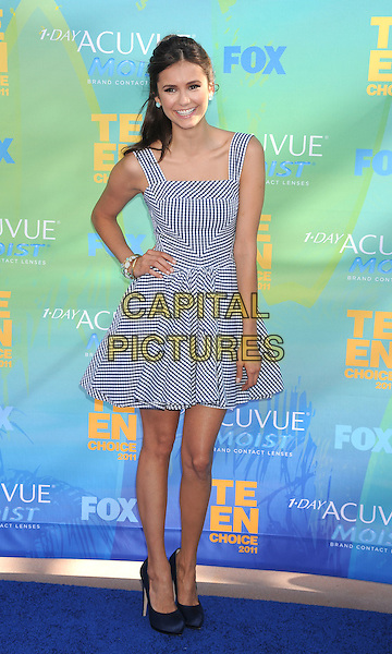 Nina Dobrev.2011 Teen Choice Awards - Arrivals held at Gibson Amphitheatre, Universal City, California, USA..August 7th, 2011.full length black dress white check gingham hand on hip.CAP/ROT/TM.©Tony Michaels/Roth Stock/Capital Pictures