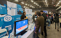 Workers from Botkeeper speak to attendees at the TechDay New York event on Tuesday, April 18, 2017. Thousands attended to seek jobs with the startups and to network with their peers. TechDay bills itself as the U.S.'s largest startup event with over 500 exhibitors. (© Richard B. Levine)