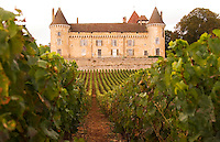 The old medieval Chateau de Rully in the Cote Chalonnaise, with vineyards with chardonnay grapes in southern Bourgogne, Burgundy, France Europe