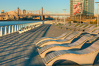 A view from Gantry Plaza State Park in Long Island City, Queens, New York including the Queensboro bridge and the historic Pepsi-Cola sign.