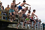 A group of jumpers hurl themselves off the Burley Bridge during the  24th annual Polar Bear Jump in Olalla, Washington on January 1, 2008. Jim Bryant Photo. ©2010. ALL RIGHTS RESERVED.