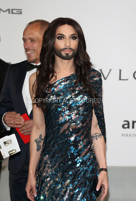 ACEPIXS.COM<br /> <br /> May 21 2014, Cannes<br /> <br /> Conchita Wurst arriving at amfAR's 21st Cinema Against AIDS Gala during the 67th Cannes International Film Festival at Hotel du Cap-Eden-Roc on May 21 2014 in Cap d'Antibes, France<br /> <br /> By Line: Famous/ACE Pictures<br /> <br /> ACE Pictures, Inc.<br /> www.acepixs.com<br /> Email: info@acepixs.com<br /> Tel: 646 769 0430
