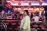 Late night along the infamous Walking Street in Pattaya , prostitutes can be seen entertaining their clients well in to the early hours of the morning. <br />