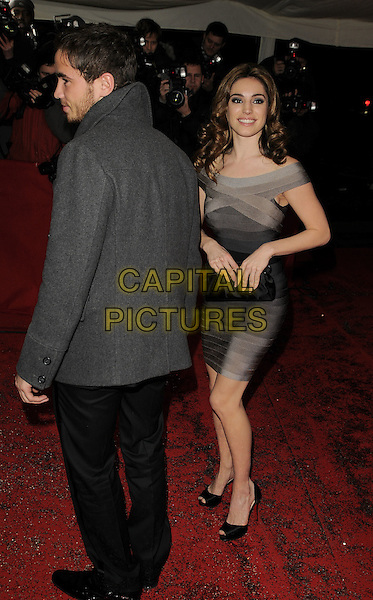 DANNY CIPRIANI & KELLY BROOK.The British Comedy Awards, London TV Studios, Upper Ground, London, England..December 6th, 2008.full length grey gray coat brown dress striped Herve Leger bandage body con peep toe Christian Louboutin shoes couple waistband off the shoulder clutch bag back behind rear profile.CAP/CAN.©Can Nguyen/Capital Pictures.