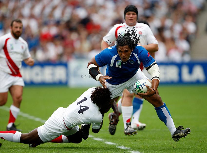 Photo: Richard Lane/Richard Lane Photography..England v Samoa. Pool A, IRB Rugby World Cup, RWC 2007. 22/09/2007. .Samoa's Henry Tuilagi is tackled by Samoa's Paul Sackey.