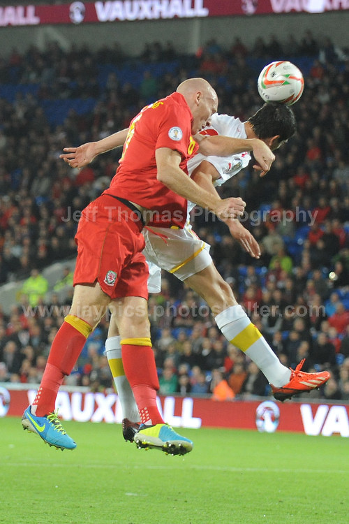 Cardiff City Stadium, Friday 11th Oct 2013. James Collins of Wales battles with the Macedonia defence for a high ball during the Wales v Macedonia FIFA World Cup 2014 Qualifier match at Cardiff City Stadium, Cardiff, Friday 11th Oct 2014. All images are the copyright of Jeff Thomas Photography-07837 386244-www.jaypics.photoshelter.com