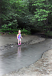 Lucia Troxell, seen exploring the waters of a stream that empties into the Esopus Creek, during a Hike It Baby/ Catskills-Woodstock sponsored hike into the Esopus Bend Nature Preserve in Saugerties, NY, on Memorial Day Monday, May 30, 2016. Photo by Jim Peppler. Copyright Jim Peppler 2016.<br /> The hike was led by HIB.Catskill-Woodstock, Ambassador, Ann Peters, accompanied by her husband, John Peters, their daughter, Violet; HIB chapter co-Ambassador, Ali Troxell, with her daughter, Lucia; and Robin Willens, and her son, Landon. They entered at the Sterley Avenue entrance and walked thru to the landing area on the Esopus.