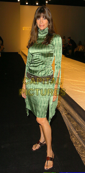 LISA B.At The Gharani Strok Show, London Fashion Week,.London, 19th September 2005.full length green satin polo neck dress leather sandals flip flops belt.Ref: CAN.www.capitalpictures.com.sales@capitalpictures.com.©Capital Pictures