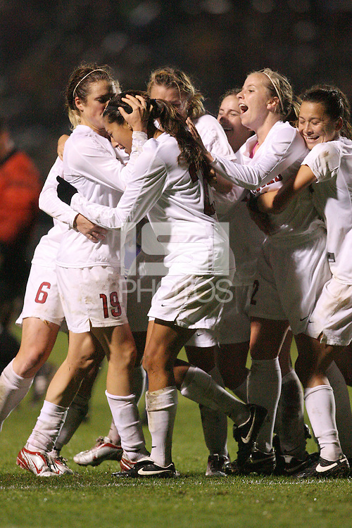 STANFORD, CA - NOVEMBER 28:  Christen Press of the Stanford Cardinal celebrates with Kelley O'Hara, Allison McCann and Ali Riley after scoring a goal during Stanford's 1-0 win in the NCAA Women's Soccer quarterfinals over the Portland Pilots on November 28, 2008 at Laird Q. Cagan Stadium in Stanford, California.