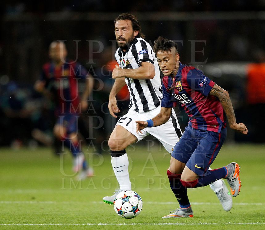 Calcio, finale di Champions League Juventus vs Barcellona all'Olympiastadion di Berlino, 6 giugno 2015.<br /> FC Barcelona's Neymar, right, is chased by Juventus' Andrea Pirlo during the Champions League football final between Juventus Turin and FC Barcelona, at Berlin's Olympiastadion, 6 June 2015. Barcelona won 3-1.<br /> UPDATE IMAGES PRESS/Isabella Bonotto