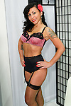 Angie Pontani poses in a Dirty Dolls Lingerie outfit during the CURVENY Designer Lingerie & Swim show, at the Jacob Javits Convention Center, August 3, 2010.