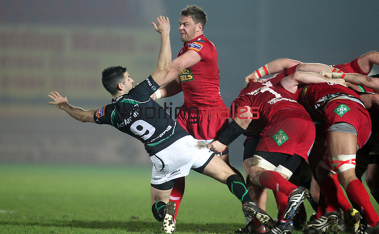 Frank Murphy loses out to Liam Davies in the scrum..RaboDirect Pro12.Scarlets v Connacht.02.03.12.©STEVE POPE