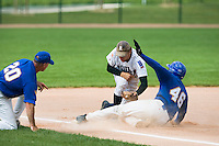 12 Aug 2007: Ernesto Martinez slides safely into third base over Nicolas Dubaut during game 5 of the french championship finals between Templiers (Senart) and Huskies (Rouen) in Chartres, France. Huskies defeated Templiers 9-8 to win their fourth french championship.