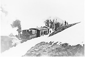 Locomotive pushing rotary plow ON which is working.  View from right rear.<br /> D&amp;RG  Ruby (Floresta) Branch, CO