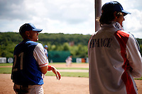 25 June 2011: Yann Dal Zotto and Eloi Secleppe of Team France. Illustration of a photographic essay called Life in the dugout, during Czech Republic 11-1 win over France, at the 2011 Prague Baseball Week, in Prague, Czech Republic.