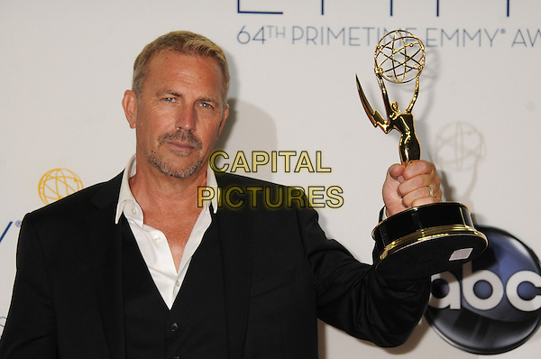 Kevin Costner.64th Primetime Emmy Awards - press room - held at Nokia Theatre L.A. LIVE, Los Angeles, California, USA..23rd September 2012.pressroom emmys half length trophy winner black suit white shirt goatee facial hair  .CAP/ADM/BP.©Byron Purvis/AdMedia/Capital Pictures.