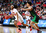 SIOUX FALLS, SD - MARCH 8: Brandon Armstrong #20 of the South Dakota Coyotes drives to the paint against De'Sean Allen-Eikens #34 of the North Dakota Fighting Hawks at the 2020 Summit League Basketball Championship in Sioux Falls, SD. (Photo by Dave Eggen/Inertia)