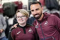 Pictured: Leon Britton with young fan. Friday 24 August 2018<br /> Re: Swansea City FC third kit launch at the club shop, Liberty Stadium, Swansea, Wales, UK.