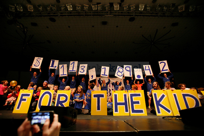 The total amount of money raised at DanceBlue 2013 at Memorial Coliseum in Lexington, Ky., on Saturday, February 23, 2013. DanceBlue is a 24 hour dance marathon in it's eighth year. Photo by Tessa Lighty | Staff