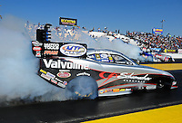 Feb. 17 2012; Chandler, AZ, USA; NHRA funny car driver Jack Beckman (near lane) does a burnout alongside Courtney Force during qualifying for the Arizona Nationals at Firebird International Raceway. Mandatory Credit: Mark J. Rebilas-