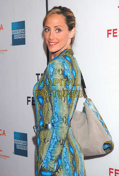"KIM RAVER.Attends the premiere of the new film, ""Slingshot"",  at the Tribeca Film Festival in downtown Manhattan, New York, USA, 26th April 2005..half length turquoise blue green snakeskin print dress bag.Ref: ADM.www.capitalpictures.com.sales@capitalpictures.com.©Patti Ouderkirk/AdMedia/Capital Picture."