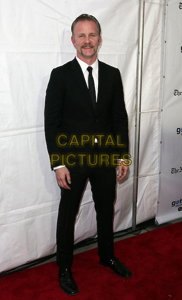 MORGAN SPURLOCK.IFP's 19th Annual Gotham Independent Film Awards at Cipriani Wall Street,  New York, NY, USA..November 30th, 2009.full length black suit.CAP/ADM/PZ.©Paul Zimmerman/AdMedia/Capital Pictures.
