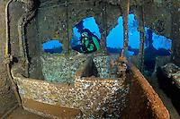 RJ41968-D. scuba diver (model released) admires tiled bathtub inside the Fujikawa Maru shipwreck, Truk (Chuuk) Lagoon, Micronesia, Pacific Ocean.<br /> Photo Copyright &copy; Brandon Cole. All rights reserved worldwide.  www.brandoncole.com