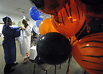 Tony Davis Jr. of Manchester and his girl friend Amanda Scheffel of West Hartford,  get ready next to a bunch of balloons the pair brought,  prior to the Great Path Academy graduation ceremony, Wednesday, June 12, 2013, at Manchester Community College. (Jim Michaud / Journal Inquirer)