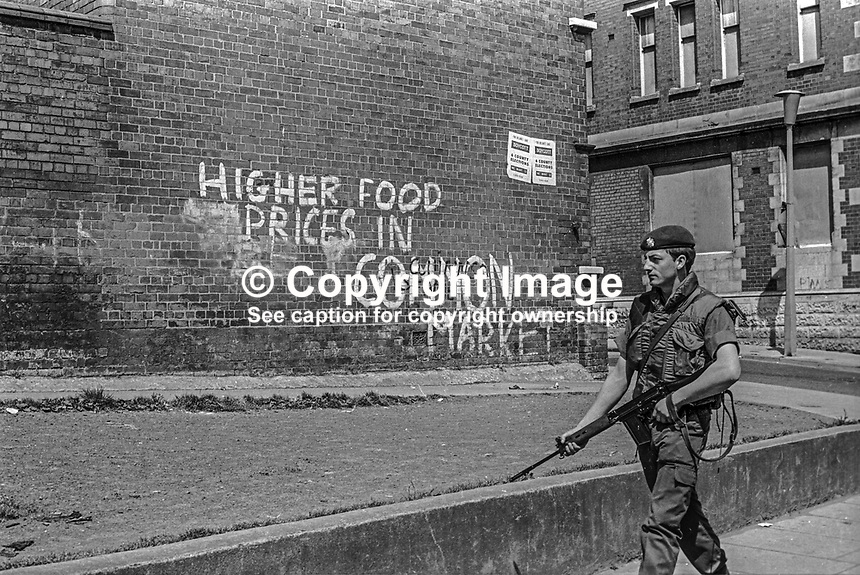 British soldier on peace-keeping duty in West Belfast passing anti-EU grafitti in the run-up to the 5th June 1975 United Kingdom European Community (Common Market) membership referendum. 197505250466<br /><br />Copyright Image from Victor Patterson, 54 Dorchester Park, <br />Belfast, UK, BT9 6RJ<br /><br />t1: +44 28 9066 1296 (from Rep of Ireland 048 9066 1296)<br />t2: +44 28 9002 2446 (from Rep of Ireland 048 9002 2446)<br />m: +44 7802 353836<br /><br />victorpatterson@me.com<br />www.victorpatterson.com<br /><br />Please see my Terms and Conditions of Use at VICTORPATTERSON.COM. It is IMPORTANT that you familiarise yourself with them.<br /><br />Images used on the Internet must be visibly watermarked i.e. &copy;VICTORPATTERSON.COM within the body of the image and copyright metadata must not be deleted. Images used on the Internet have a size restriction of 4kbs and are chargeable at the then current NUJ rates.<br /><br />This image is only available for the use of the download recipient i.e. television station, newspaper, magazine, book publisher, etc, and must not be passed on to any third party. It is also downloaded on condition that each and every usage is notified within 7 days to victorpatterson@me.com<br /><br />The right of Victor Patterson to be identified as the author is asserted in accordance with The Copyright Designs And Patents Act (1988).