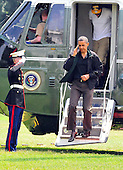 United States President Barack Obama salutes as he and his family return to the South Lawn of the White House in Washington, D.C. from a weekend at Camp David, the presidential retreat near Thurmont, Maryland.  Exiting behind him is Avery Robinson (the Obamas' nephew)..Credit: Ron Sachs / Pool via CNP