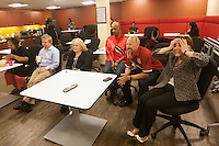 San Francisco, CA - Tuesday, July 1, 2014: Employees at Arthur J. Gallagher insurance company, including Zack Phillips, watch the USA vs. Belgium World Cup Round of 16 game in San Francisco.